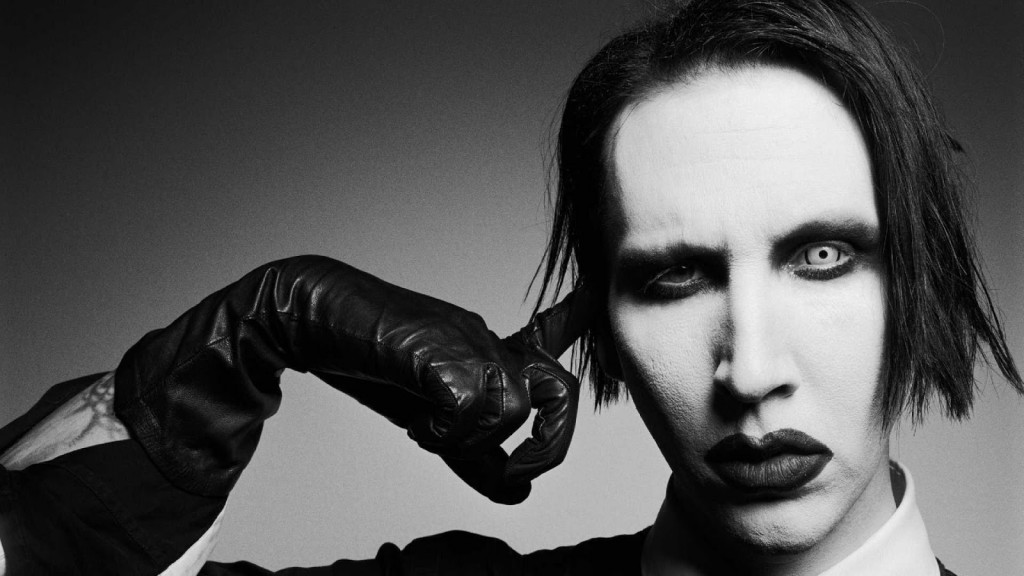 Marilyn Manson trying to shoot himself with finger - fails to emit bullet.