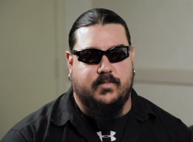 Mick Thomson looking like a member of a Mexican drug cartel.